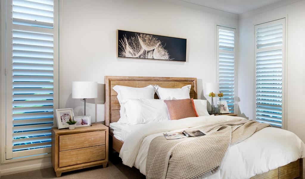 Window Treatment white shutters in bedroom