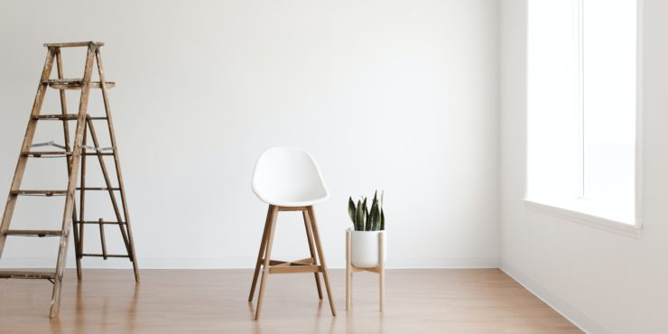 Plain White Room with Chair Plant and Ladder